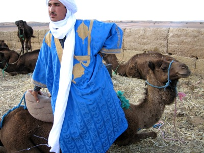 Tuareg-Man-In-Sahara-With-Camel