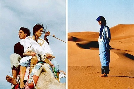 Merzouga-Sahara-Desert-Couple-On- Camel-Tuareg-Man